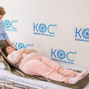 перемещение лежачих больных в кровати